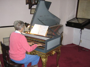 Gena Churchill playing the harpsichord