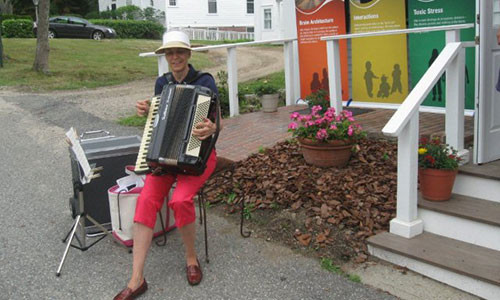 Gina playing the accordion